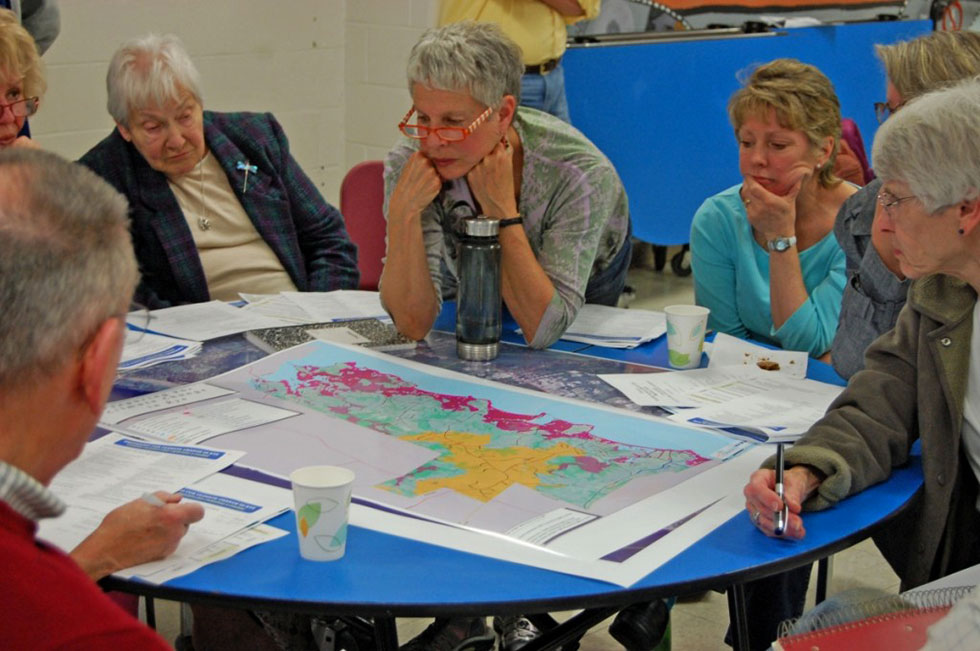 Rye residents meet to discuss preliminary sea-level rise scenario maps and identify community vulnerabilities. Photo by Rebecca Zeiber.