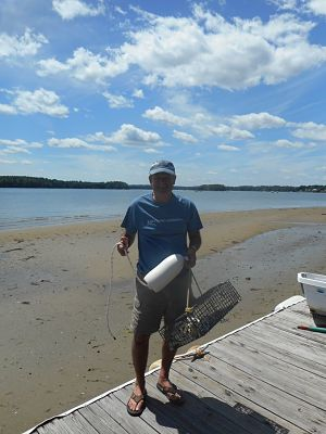 Oyster Conservationist volunteer excited to receive his baby oysters. © The Nature Conservancy