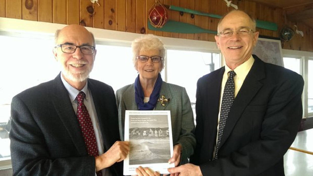 Cliff Sinnott, Senator Nancy Stiles, and Senator David Watters hold the final report of the New Hampshire Coastal Risk and Hazards Commission