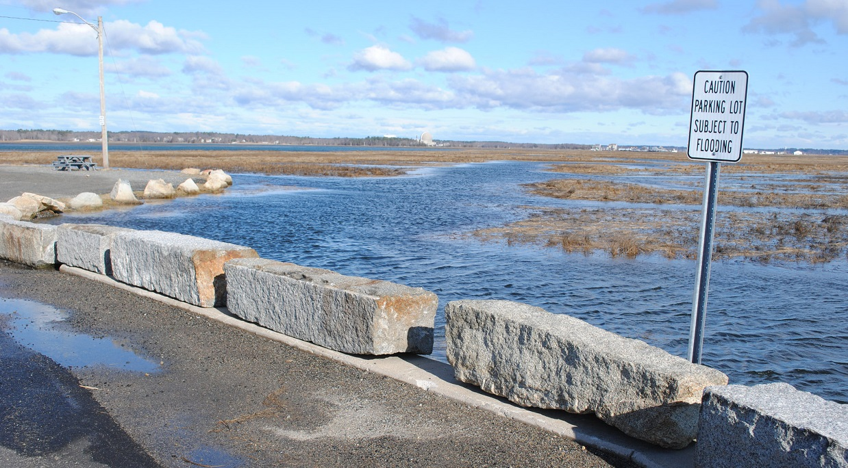 a parking lot nearly flooded at high tide in Seabrook, NH