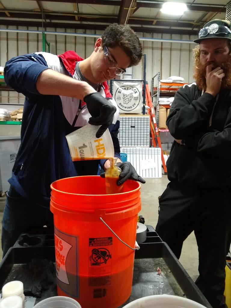Students taking samples to measure nutrient load from fermenters at Stoneface Brewing Co. The Brewery sidesteams so that it does not go down the drain. Photo: Cheryl Parker