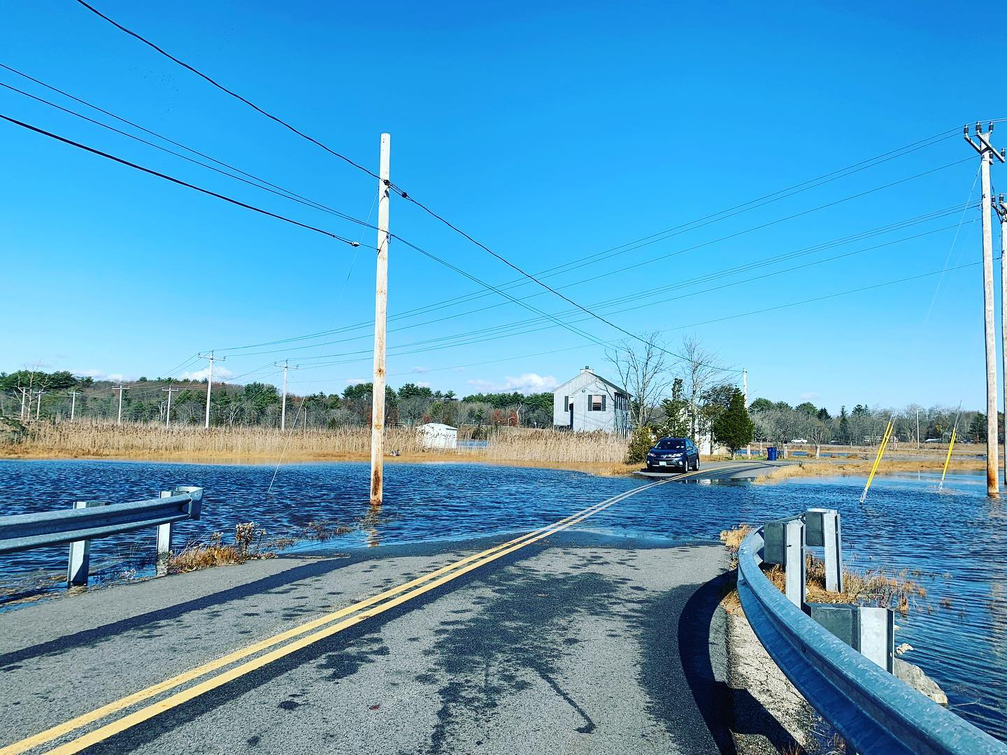 Road flooded during King Tide event