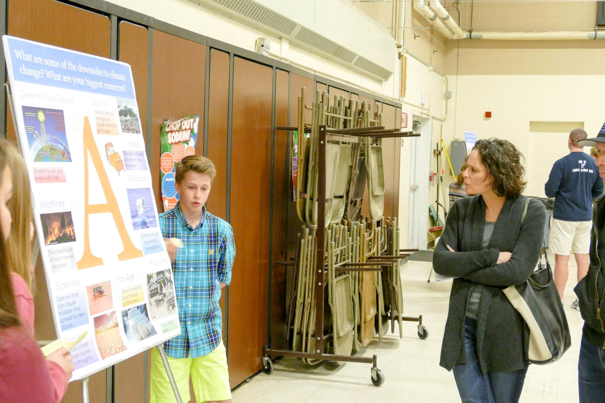 Students present a poster about climate change at a Climate in the Classroom event