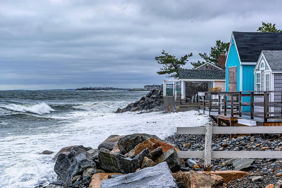 The tide encroaches on seaside housing