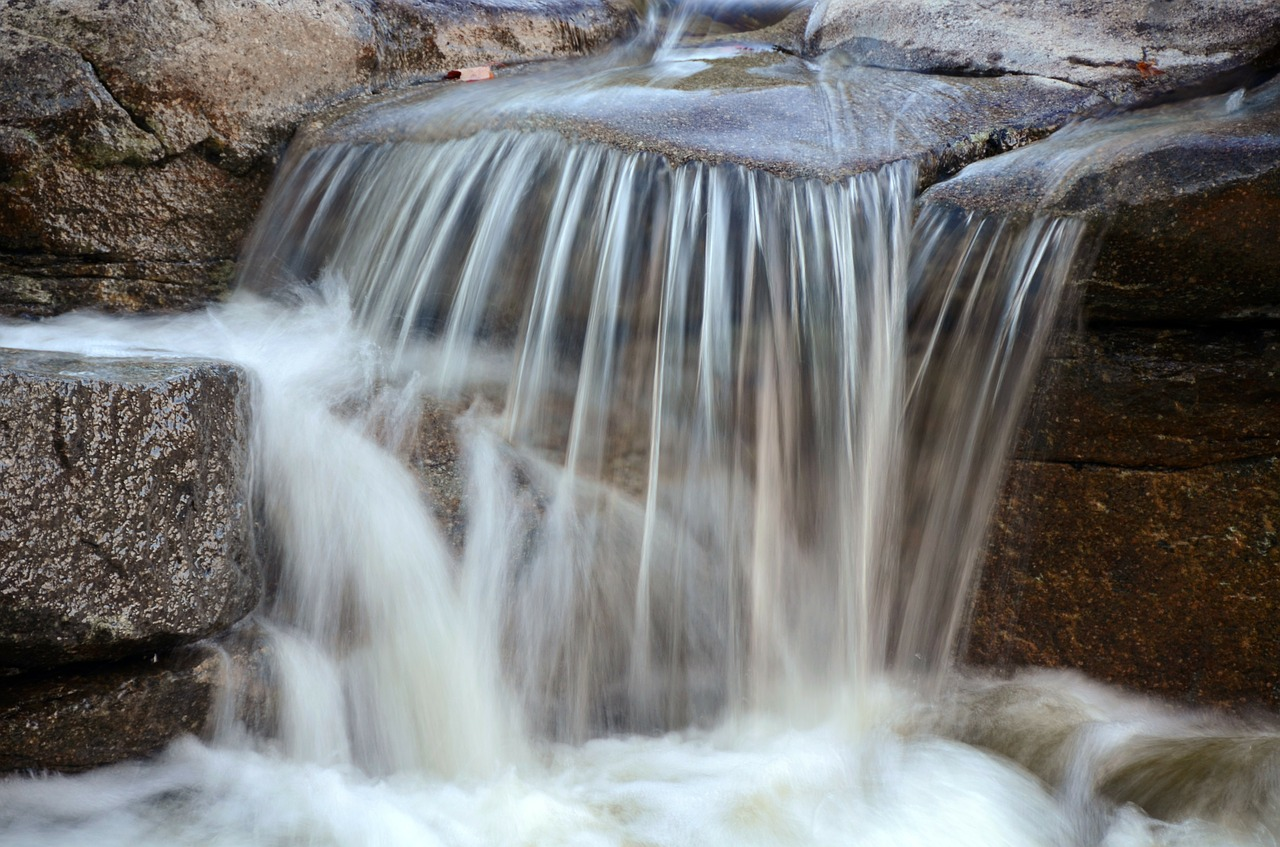 Close up of water flowing over rocks
