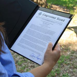 Senator Pappas reads Congressional Record award for Rayann Dionne